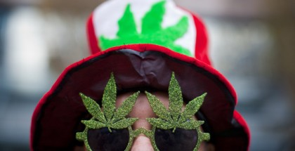 A man, wearing a marijuana-themed hat and sunglasses, is pictured at the Vancouver Art Gallery during the annual 4/20 day, which promotes the use of marijuana, in Vancouver, British Columbia April 20, 2013.  REUTERS/Ben Nelms    (CANADA - Tags: HEALTH SOCIETY POLITICS CIVIL UNREST DRUGS)